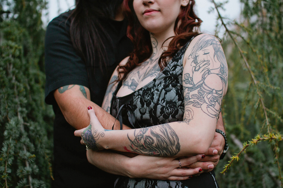 tattooed couple embraces during engagement photo session with markow photography at grounds for sculpture in hamilton nj