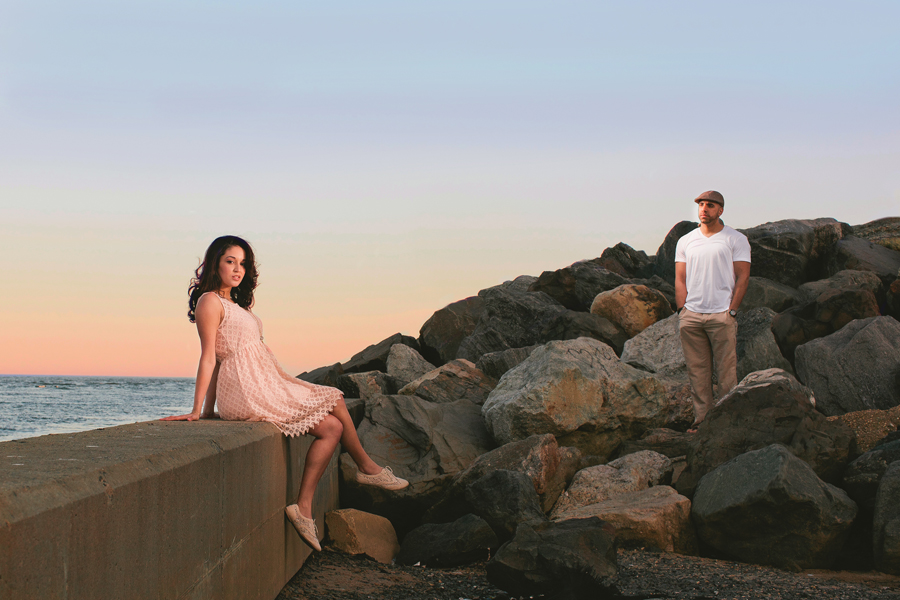 Couple poses at Point Pleasant inlet during their engagement photo session with their monmouth county nj wedding photographers markow photography