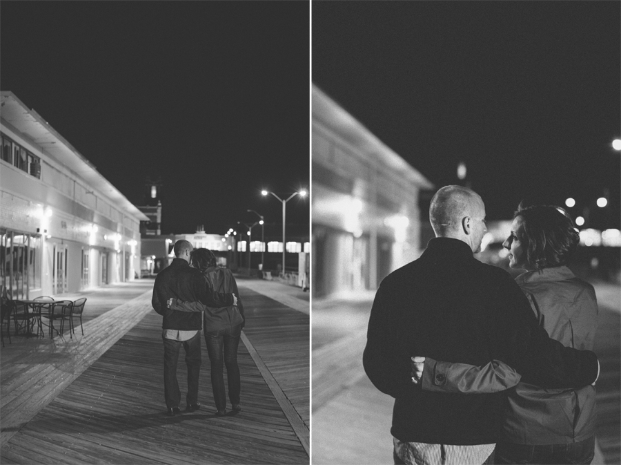 couple embraces at asbury park nj during their engagement photo session with their monmouth county nj wedding photographers julianne and steven of markow photography
