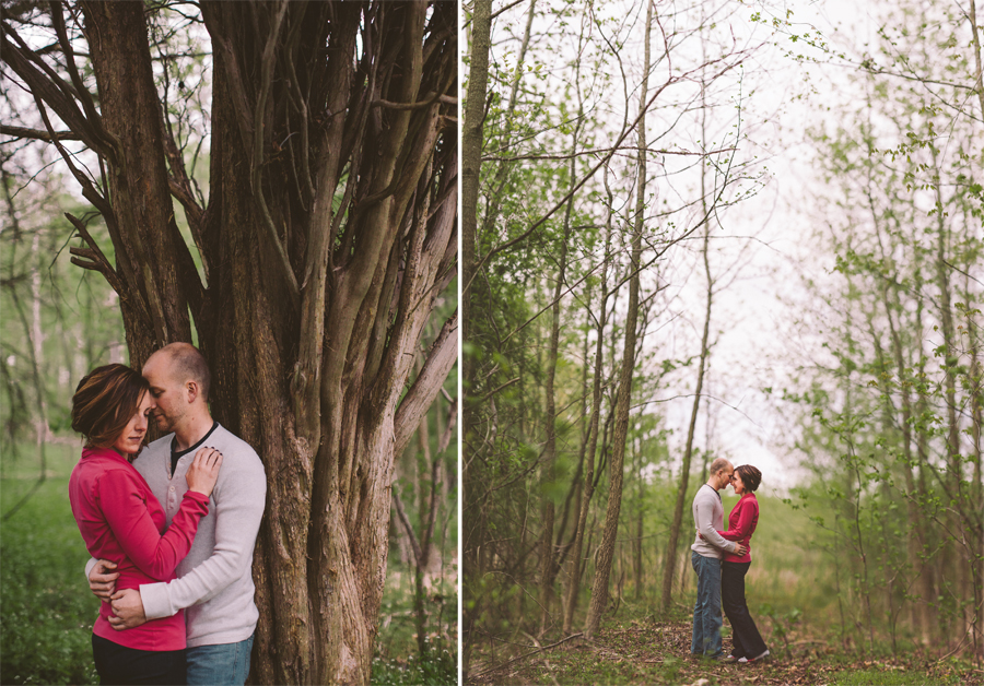 couple embraces at the manasquan reservoir during their engagement photo session with their monmouth county nj wedding photographers julianne and steven of markow photography