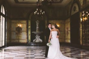 wedding portrait of bride and groom in wilson hall at monmouth university by monmouth county nj wedding photographers