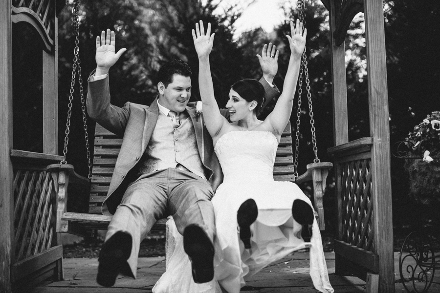 The English Manor Wedding Photographers bride and groom swinging on swink=g