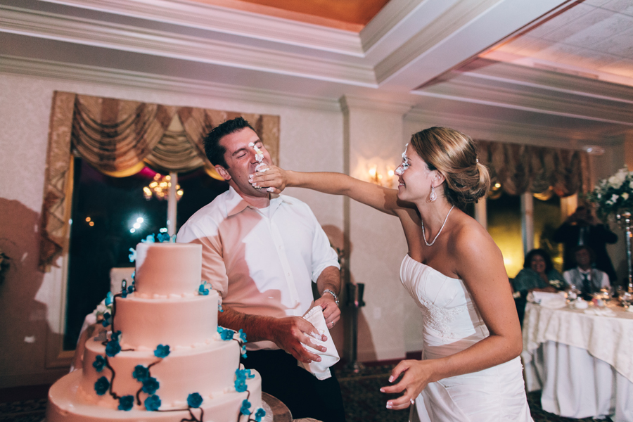 bride smashes cake on groom