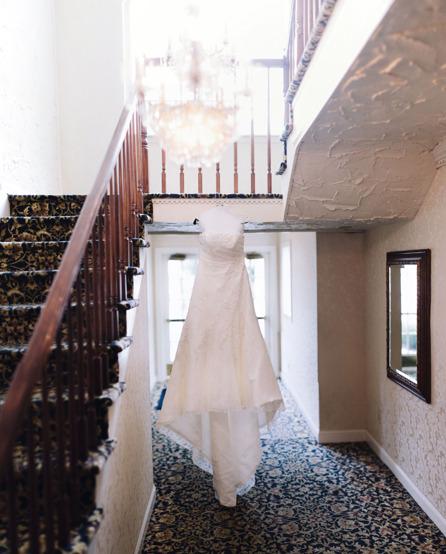 wedding dress hanging at the english manor