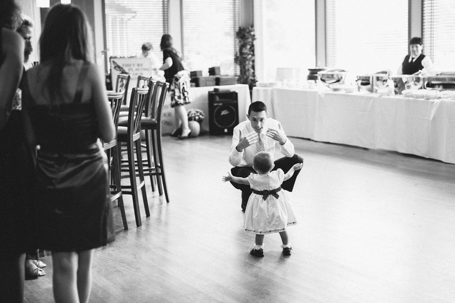 baby takes her first steps during wedding