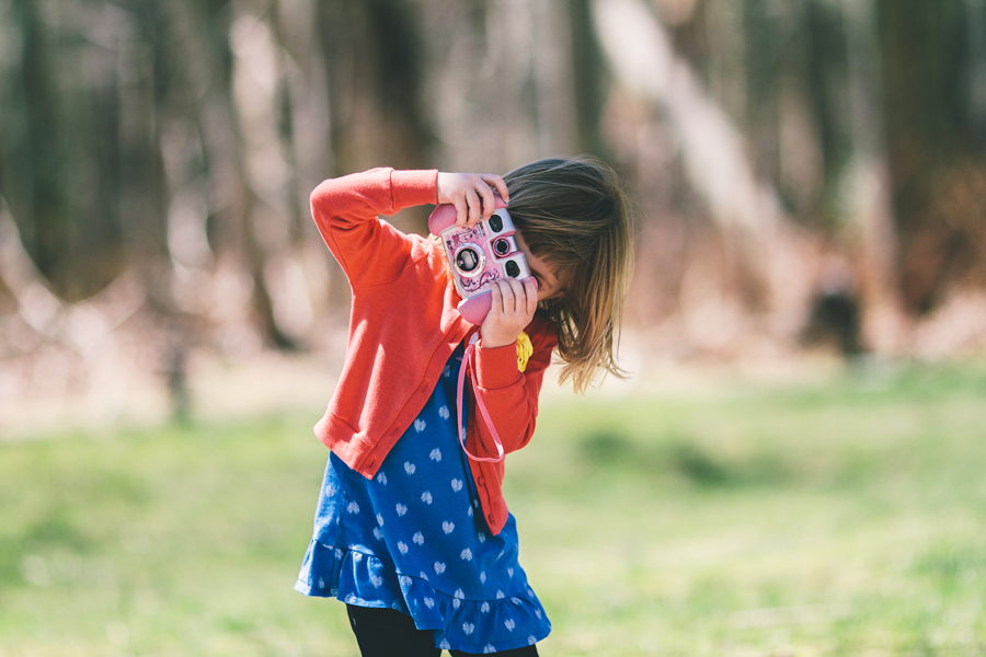 little girl taking pictures