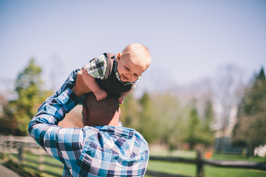 father holding baby in the air