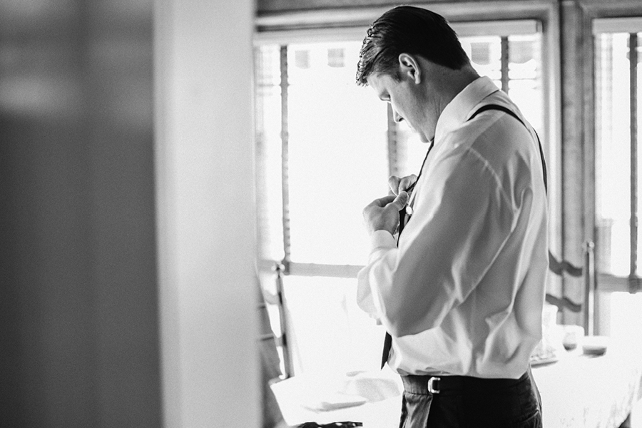 creative groom getting ready photo