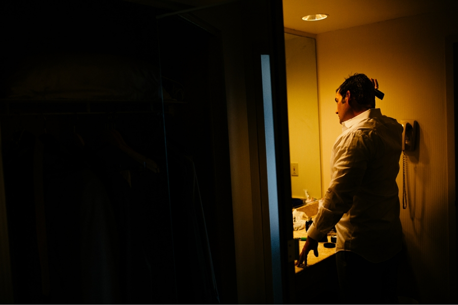 groom getting ready in hotel nj
